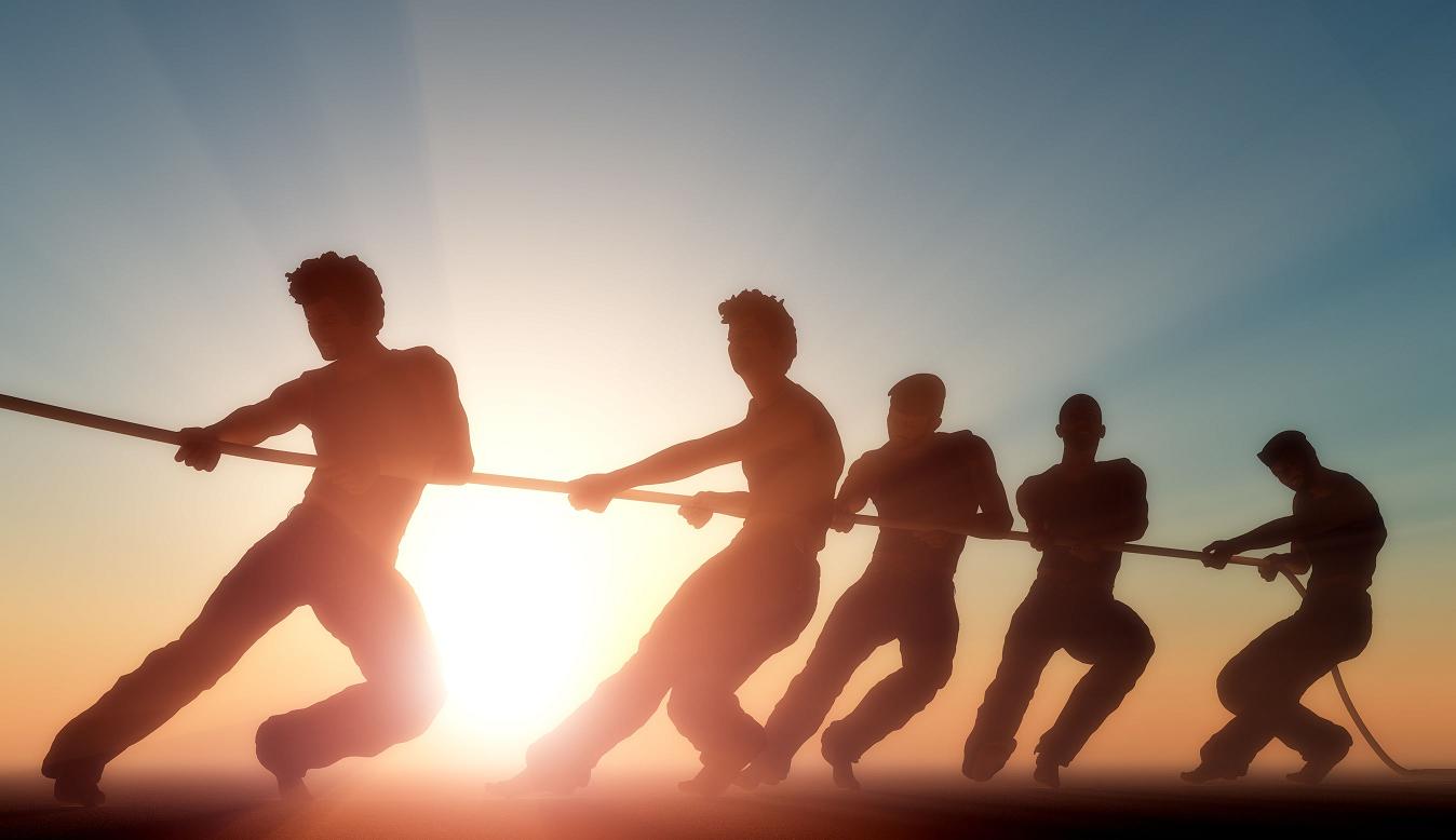 Teamwork winning a tug-o-war
