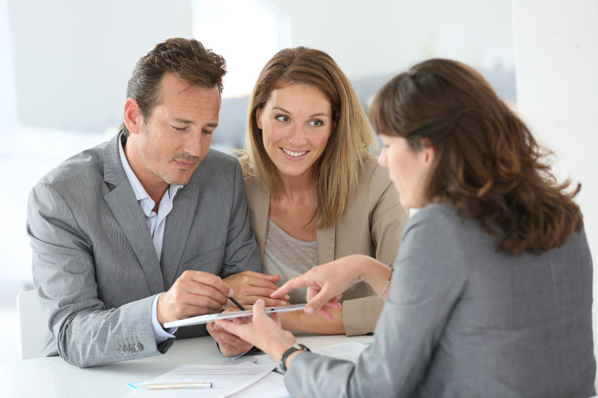 Couple signing a tenant lease