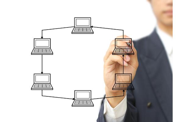 Man drawing computer diagram